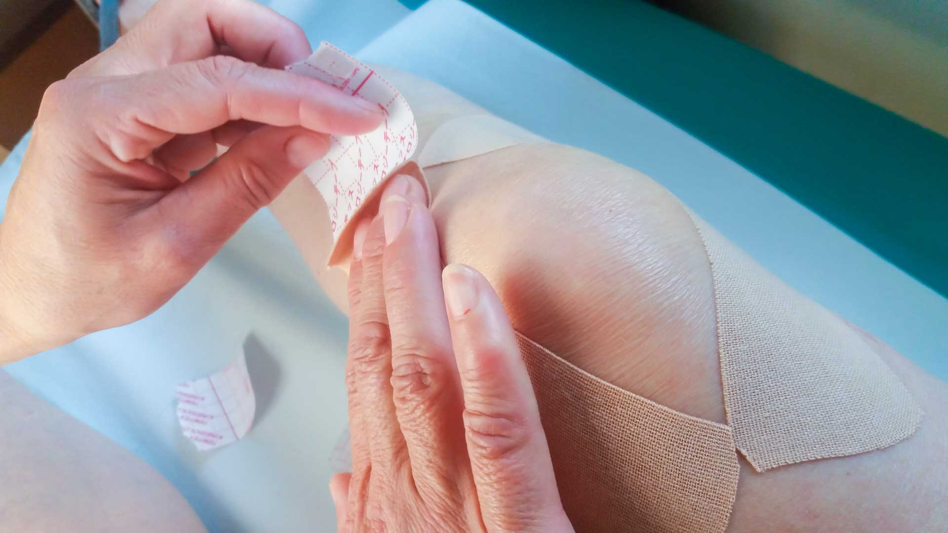 applying_adhesive_bandage_to_knee